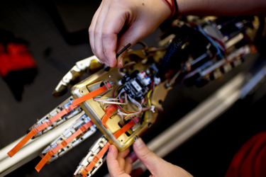 Person working on robotic hand