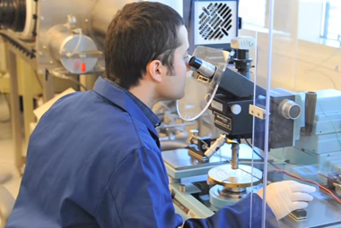 Student looking through microscope for ms mechanical engineering