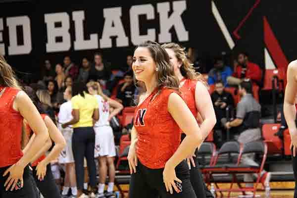 student on cheerleading team